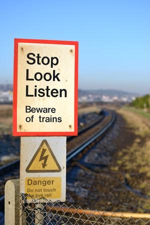Stop, look and listen train crossing warning sign Banco de Imagens