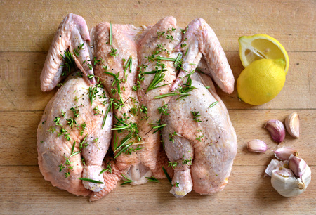 boned: Raw spatchcock chicken with garlic herbs and lemon