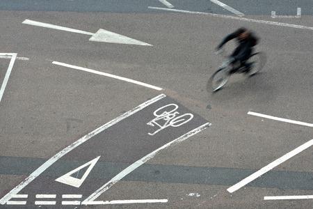 Bicycle crossing road using cycle lanes, uk