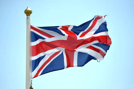 tattered: tattered union jack british flag on a windy day brexit Stock Photo