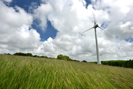 Wind turbine in tall grass at Glyndebourne, Sussex Stock Photo
