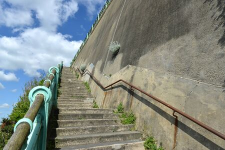 seaside town: Steps and concrete wall in a seaside town, uk Stock Photo