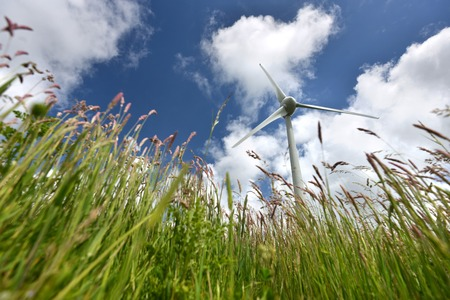 blustery: Wind turbine in tall grass at Glyndebourne, Sussex Stock Photo