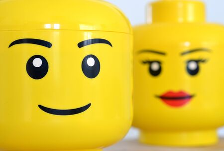 Girl and boy lego heads, close up