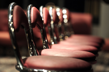 Row of red bar chairs, soft focus