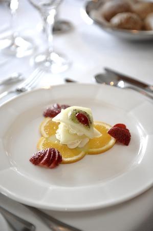 restaurant setting: Pudding of melon sorbet in a restaurant setting