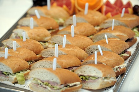 lunch tray: Platter of ham rolls for buffet lunch