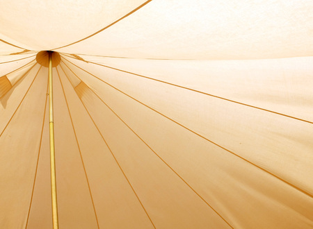 Interior of a traditional canvas bell tent - background Standard-Bild