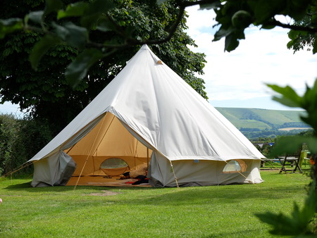 Traditional canvas bell tent in english countryside Stock Photo