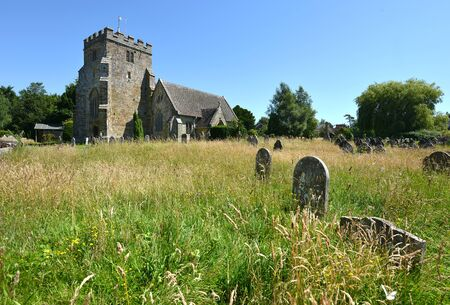 typical: Typical country village church with overgrown graves