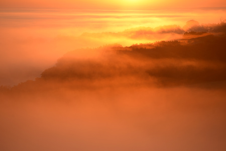 Sunrise over thick low cloud i the South Downs National Park