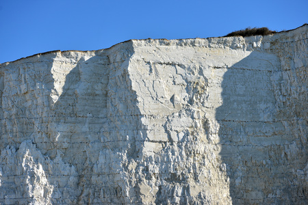 sheer: Sheer chalk cliffs on the Sussex coast Stock Photo