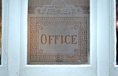 etched: Victorian office sign etched onto a window Stock Photo