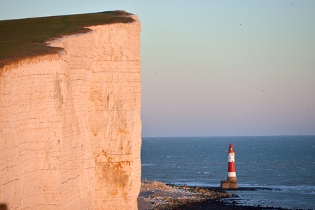 Lighthouse at Beachy Head with sheer chalk cliffs