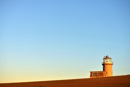tout: Belle tout lighthouse bathed in evening sun Stock Photo