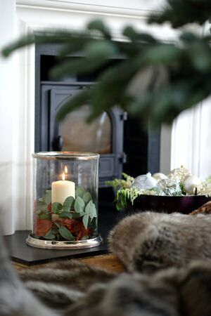 Traditional festive christmas decorated fireplace with candles