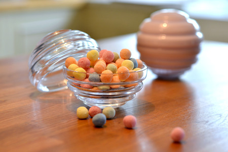 Colorful sweets in a round glass jar