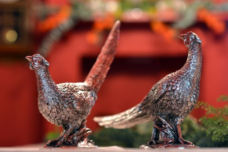 Metal animal figures on a Christmas table setting. Stock Photo