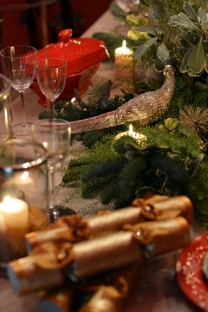 Decorated Christmas table with animal figures and colorful plates