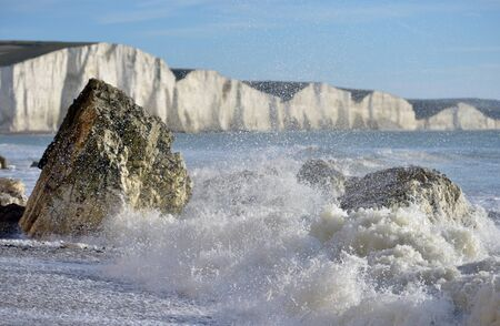 sea spray against coastal rocks of the Sussex Coast Stock Photo