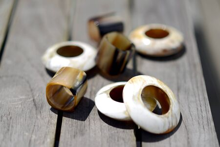 napkin ring: Natural horn napkin rings outside on a sunny day
