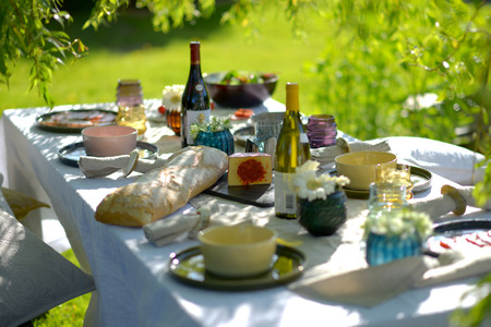 Alfresco dining, table set for an evening meal outside Stock Photo