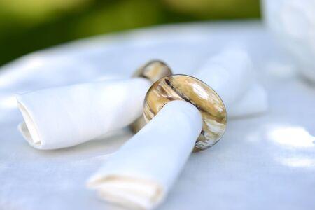 napkin ring: White linen napkins in natural horn napkin rings