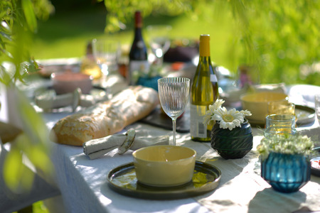 alfresco: Alfresco dining, table set for an evening meal outside Stock Photo