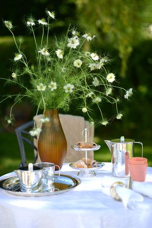 Alfresco coffee from silver coffee pot on linen