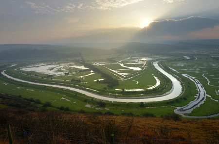 Cuckmere river in the South Downs National Park on a misty morning