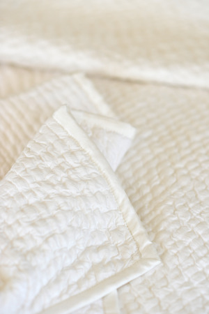 bedspread: Bedroom setting with luxury pillows, shams and duvets
