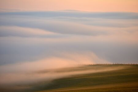 Low cloud on the South Downs at sunset Stock Photo