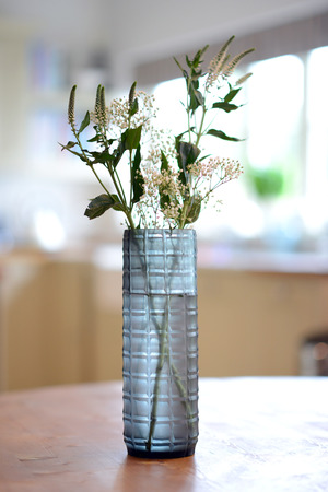 sided: blue, straight sided decorative glass vase with checker pattern. Stock Photo