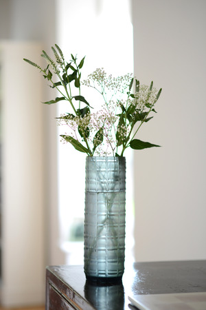 blue, straight sided decorative glass vase with checker pattern. Stock Photo
