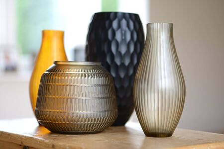 four objects: Group of four decorative cut glass vases in a room Stock Photo