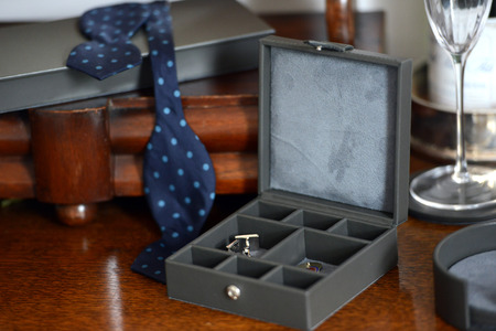 Brown leather box with bow tie cigar cutter and cufflinks Stock Photo