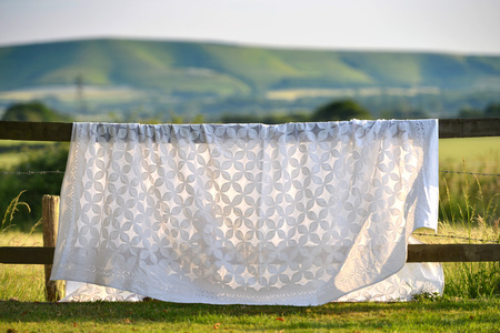 white sheet  table cloth hanging in a country garden Stock Photo