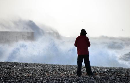 Huge waves striking Newhaven breakwater, UK, during a winter storm