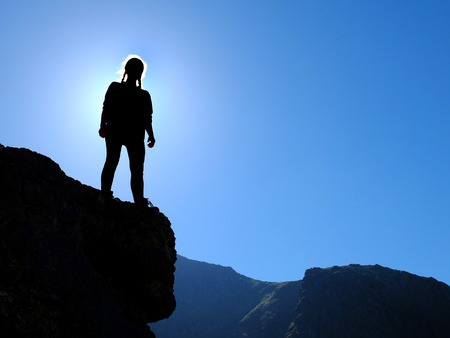 cumbria: Teen girls standing on rocky outcrops in the fells of the English Lake District Stock Photo