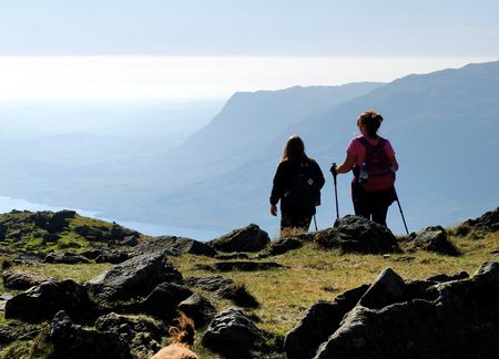 cumbria: Two women hiking on the Lake District fells Editorial