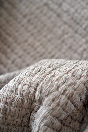 Quilted textured grey soft bedding material Stock Photo
