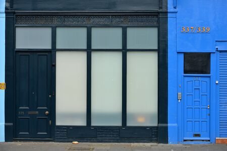 Black and blue painted shop fronts in London