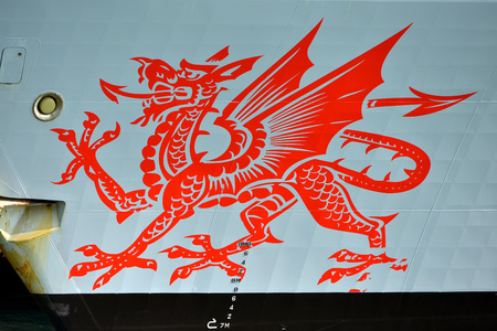 Welsh red dragon emblem on the side of a ship Stock Photo