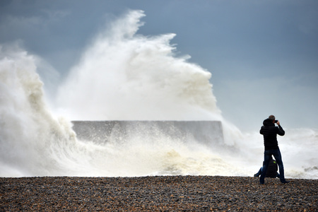 Huge storm waves battering Newhaven breakwater and lighthouse, Sussex, UK