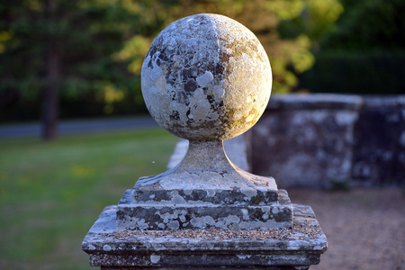Round stone wall ornament in a country house Stock Photo