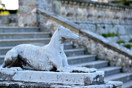 greyhound: Stone greyhound ornament in the grounds of a country house