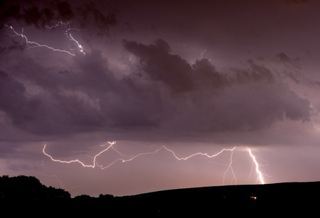 Dramatic lightning over the South Downs in East Sussex Stock Photo