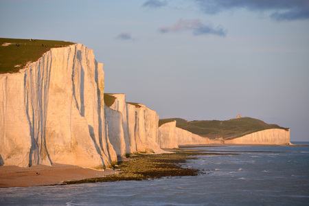 Seven Sisters chalk cliffs in East Sussex at sunset. Stock Photo