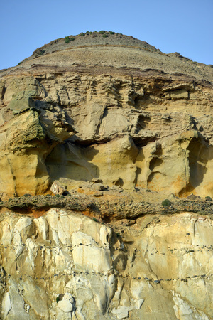 Cliffs showing strata of sandstone above chalk