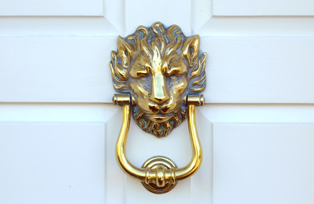 Old Victorian brass lion head door knocker